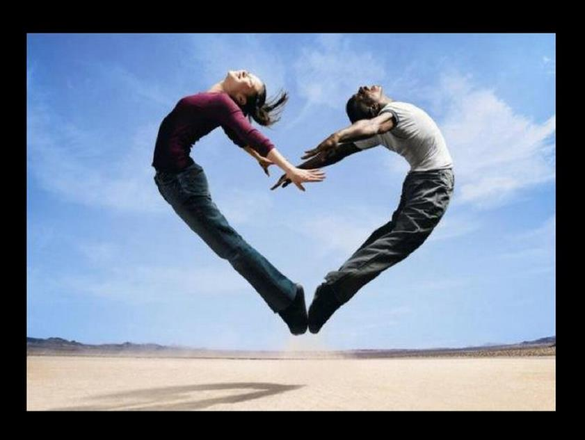 Heart shape formed by man and girl jumping